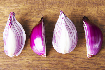 Raw red sliced onion.