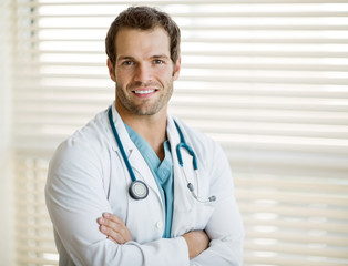 Confident Male Doctor With Arms Crossed