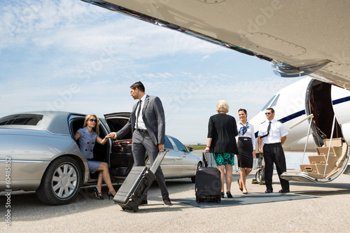 Leinwanddruck Bild Business Partners About To Board Private Jet