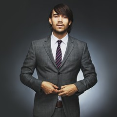 Attractive young male model wearing stylish suit