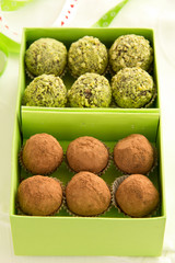 Homemade chocolate truffles and pistachio.