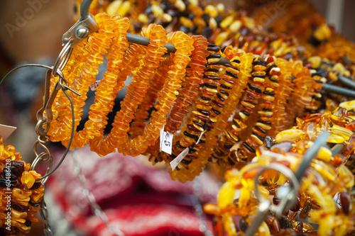 Amber beads and bracelets on the counter. Riga, Latvia