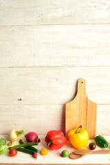 Colorful vegetables with cutting board