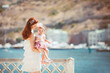 Portrait of a young mother and baby having fun on the waterfront