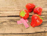 Strawberry chewing gum on wooden background
