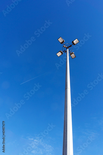 spotlights against blue sky
