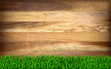 Wooden boards with green grass.