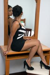 woman sitting near a mirror