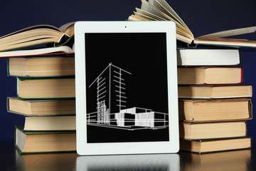 Tablet with house sketch project and books