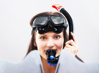 Portrait of a girl in snorkeling gear on light background