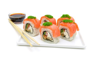 rolls with a salmon on a plate on a white background close-up.