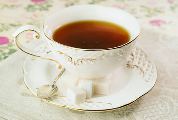 Gourmet tea cup with sugar cubes