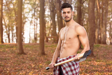 Muscular young man with axe