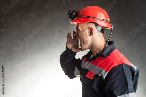 Angry coal miner shouting - 60489427