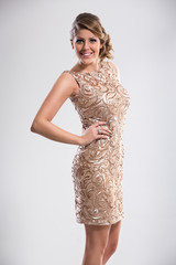 Attractive woman in sequin dress
