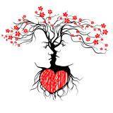 Silhouette of kissing couple shaped by tree.