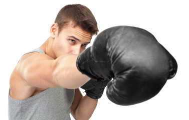 young boxer making punch