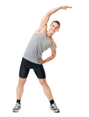 Smiling athlete doing exercises