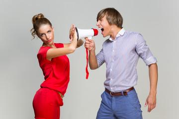 Young man screaming at girlfriend