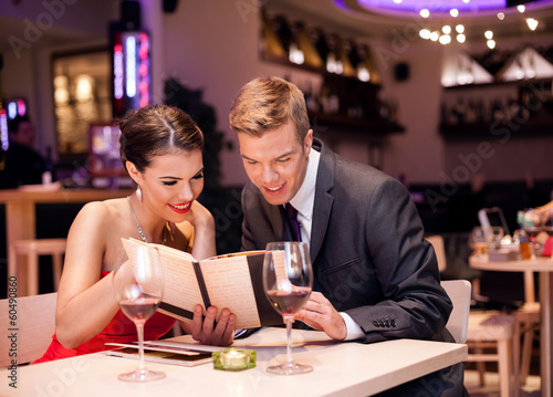 Couple reading menu together