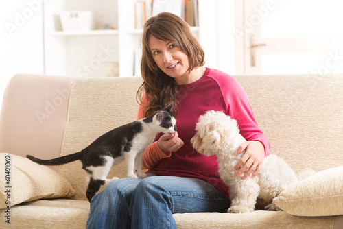 Owner with cat and dog