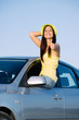 Positive woman on car travel