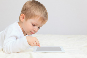 Little boy with touch pad
