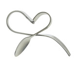 Fork and spoon bent in shape of heart isolated