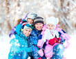 Winter portrait of happy young family