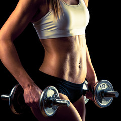 Fitness girl - attractive young woman working out with dumbbells