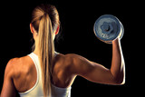 Fototapety Fitness girl - attractive young woman working out with dumbbells