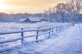 Fototapety Rural house with a fence in winter