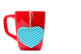 Red mug with heart shape isolated on white background