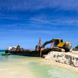 bulldozer working on a beach