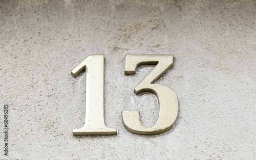 Number thirteen on a wall