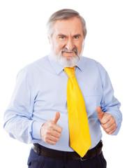 Smiling senior man giving thumbs up