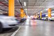 Parking garage, underground interior with a few parked cars - 60497073