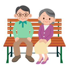ベンチで休憩するシニア夫婦