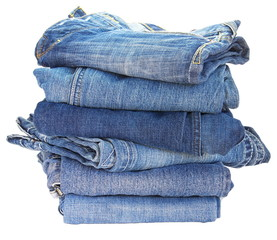 Lot of different blue jeans close-up