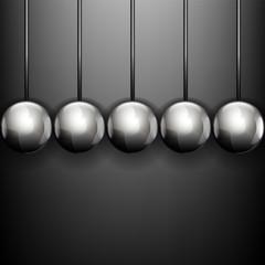 пять металлических шаров на сером фоне