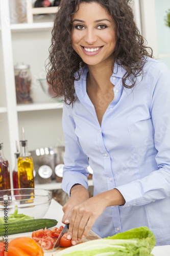 Woman Preparing Healthy Food Salad in Kitchen