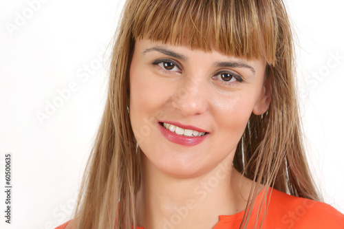 Portrait of young cheerful smiling woman, over grey background