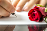 Man writing a letter to his sweetheart