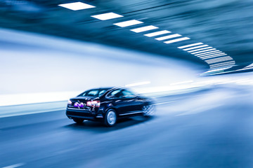 Interior of an urban tunnel with car,motion blur
