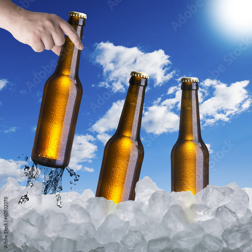 Hand Pick up Beer In Ice Cubes