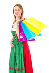 Bavarian woman in dirndl on shopping tour