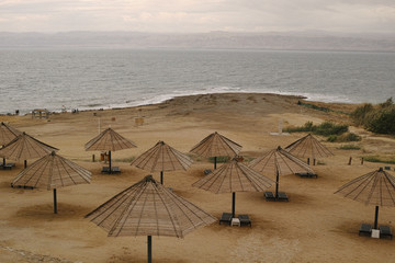 View of a beach with umbrellas on the shore of the Dead Sea from