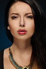 Closeup face of brunette woman with fashion makeup and red lips