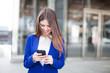 Pretty woman using her smart phone
