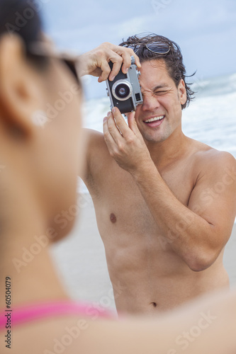 Couple at Beach Taking Photographs